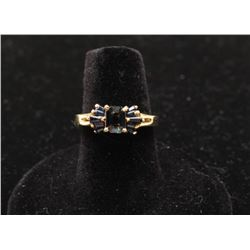 Emerald cut sapphire ring set in 14k yellow gold with