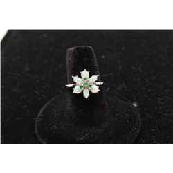 Flower design opal and emerald ring in 14k white gold.