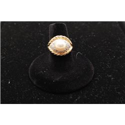 14kt yellow gold ring set with a round akoya pearl