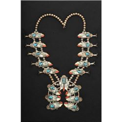 Fancy squash blossom necklace mounted with natural turquoise nuggets and