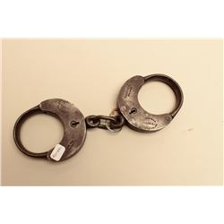 Scarce Romer  Co. handcuffs with key; marked Made for