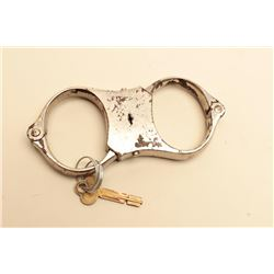 Scarce Beans Giant handcuffs with key; circa 1887. In working