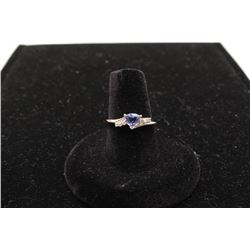 One ladies ring in platinum set with a trilliant tanzanite