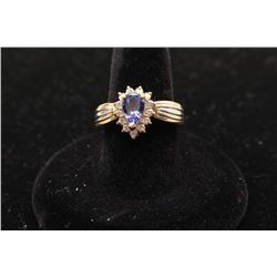 One ladies ring in 14k yellow gold set with a