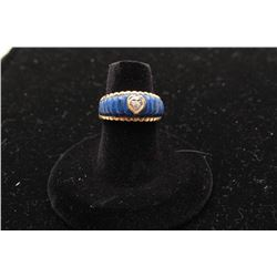 One 14k yellow gold ladies ring inlaid with lapis lazuli