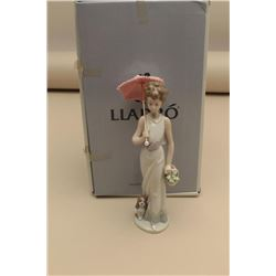 Lladro Garden Classic of a Beautiful Lady with an umbrella, holding