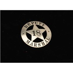 Vintage 5 point star in circle badge marked Deputy Marshal/18.