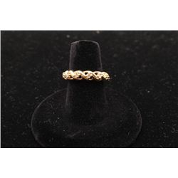 Unique twisted 14k yellow gold band set with 11 diamonds
