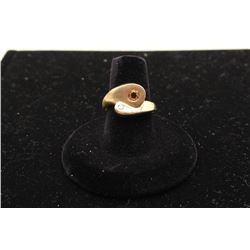 Modern bypass ring in 14k yellow gold set with a