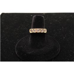 14k yellow gold 5 diamond bezel set ladies ring with