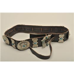 German silver marked concho belt mounted with nuggets of turquoise.
