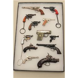 Lot of 12 different miniature toy guns; 3 with key