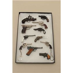 Lot of 11 different miniature toy guns; 2 with key