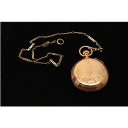 Antique American Watch Co. pocket watch in  14K gold case with watch chain; running at  time of desc