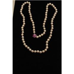 "6.5mm pearls 24"" strand. Estate Consigned.  Est.: $200-$400."