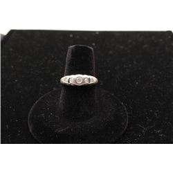 Modern 14k white gold ladies ring with 5  bezel set diamonds. Est.: $300 -$600.