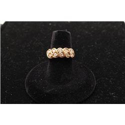 14k yellow gold ladies ring set with 10 roped  in diamonds. Est.: $300 -$600.