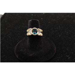 Modern ladies ring in 14k yellow gold with  bezel set oval topaz and 6 diamonds. Est.:  $500 -$1,000