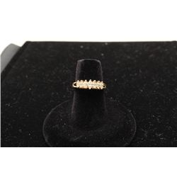 14 kt yellow gold ladies ring set with 7  marquee diamonds weighing approx 0.5ct, Est.:  $750 -$1,50