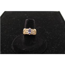One ladies ring set with a marquee tanzanite  approx 0.75ct and set with 18 diamonds   0.50ct. Est.: