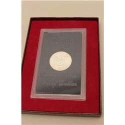 Eisenhower United States Proof Dollar in  plastic case marked packaged by U.S. Mint.   The plastic c