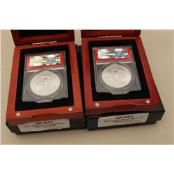 Two 25th Anniversary Silver Eagle First  Release coins; ANACS-MS70 slabbed and each in  wood display