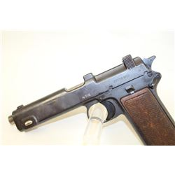 Steyr Model 1913 Semi-Auto pistol with import  marks and arsenal type re-blue. Marked 9mm  on the le
