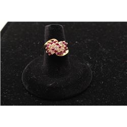 One ladies ruby and diamond cluster ring made in 14k