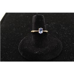One ladies solitaire ring in 14k yellow gold set with