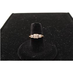 One ladies 3 diamond step ring in 14k yellow gold.