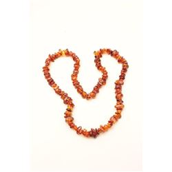 One strand of genuine amber beads 36inches long. Est.: $300-$600