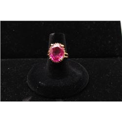 Vintage 14kt yellow gold ring with lab created pink stone