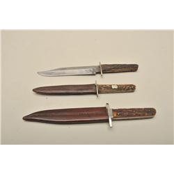 Good lot of 2 shefield sheath knives with scabbards. Along