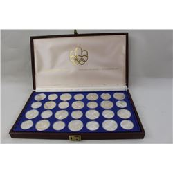 Cased set of 28 Canadian 1976 Olympics  commemorative proof coins. 30.44 OZ. Pure  silver. Est.: $40