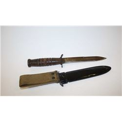 US WW II M3 fighting knife and sheath,  similar to a Ka-Bar - unmarked, repainted  scabbard.  Est $7