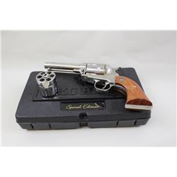 "Ruger Vaquero stainless #58-09436, 40 S&W and  38-40 cal, dual cylinder, 4 5/8"" barrel,  hardwood gr"