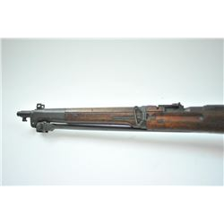 Japanese Arisaka 6.5 carbine with folding  bayonet, dust cover retained, mum defaced but  partially