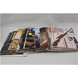 Box of Mossberg factory catalogs 1961-2013.  30 annual catalogs plus 9 extras and package  of misc.