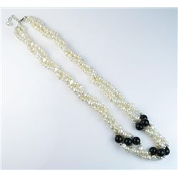 Ladies freshwater pearl necklace of black  onyx and sterling silver bead combination.  Est:$100-200
