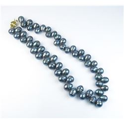 Ladies freshwater black Baroque style pearl  necklace of approx 18 inches in length.  Est:$100-200