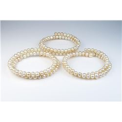 Nice lot of three freshwater pearl bangle  bracelets of a peach cream color combination.  Est:$100-2
