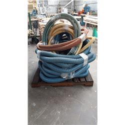 Pallet full of flexible pipe and hoses