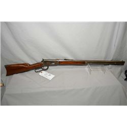 "Winchester Model 1894 .32 - 40 Cal Lever Action Rifle w/ 26"" round barrel full mag [ traces of blue"