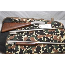 New England Firearms Co. Model Ducks Unlimited Canada Handigun S.B. 2 .30 - 30 Win Cal and .20 Ga 3""