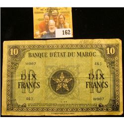 """FRENCH MORROCCO TEN DIX NOTE """"SHORT SNORTER"""" DATED 1944.  SHORT SNORTERS ARE NOTES THAT ARE SIGNED."""