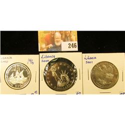 FIVE DOLLARS COINS FROM LIBERIA INCLUDING ONE COMMEMORATING THE DOOLITTLE RAID AND STAUTE OF LIBERTY