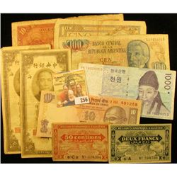 FOREIGN BANK NOTE LOT INLUDES TEN YUAN NOTE FROM CHINA DATED 1935, ALGERIA 1949 NOTES, ARGENTINA, 2