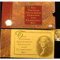 THOMAS JEFFERSON COINAGE AND CURRENCY SET.  THIS SET INCLUDES A SILVER 1993 UNCIRCULATED THOMAS JEFF