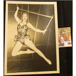 "Black & White 5"" x 7"" photo of Betty Hutton on a trapeze. Personally autographed by Betty Hutton."
