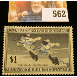 1947 RW14 Federal Migratory Bird Hunting $1 Stamp, signed and obviously used for hunting.